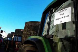 Cartel nun tractor na muralla.